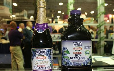 Bottles of Welch's/Manischewitz grape juice at Kosherfest in Secaucus, New Jersey. (Uriel Heilman/JTA)