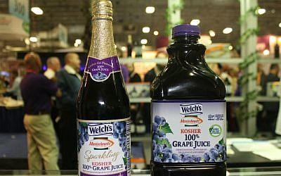 Bottles of Welch's/Manischewitz grape juice at Kosherfest in Secaucus, New Jersey. (Uriel Heilman/JTA)