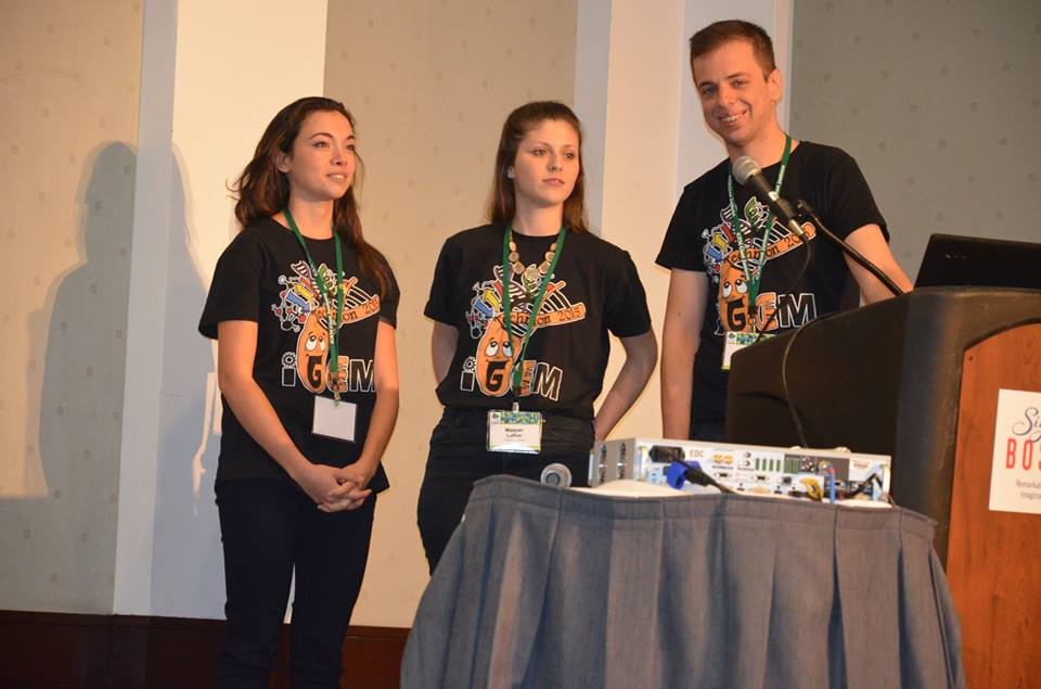 Yael Annis, Maayan Lufton and Alexey Tomsov present at the iGEM conference in September (Facebook)