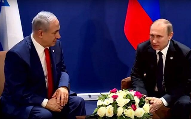 Prime Minister Benjamin Netanyahu (left) meets with Russian President Vladimir Putin on the sidelines of the COP 21 United Nations conference on climate change at Le Bourget, on the outskirts of Paris, France, on November 30, 2015. (screen capture: YouTube)