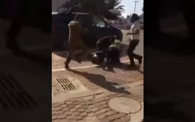 A screen capture of online footage of the beating of a Bedouin youth by Jewish passers-by on November 8, 2015, outside the Beersheba Mall. (screen capture/YouTube)