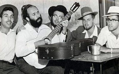 A young Rabbi Shlomo Carlebach playing guitar. (YouTube screenshot)
