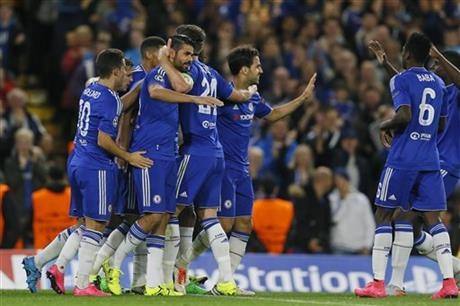 Chelsea players hug teammate Diego Costa, center left, after he scored during the Champions League group G soccer match between Chelsea and Maccabi Tel Aviv at Stamford Bridge stadium in London, Wednesday, Sept. 16, 2015 (AP/Kirsty Wigglesworth)