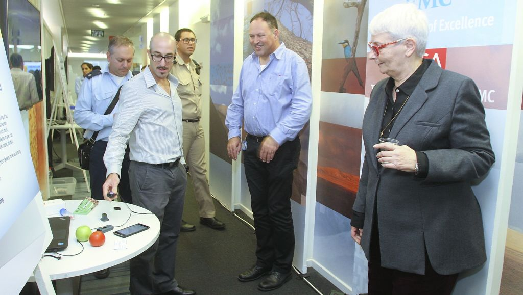EMC Israel chairperson Orna Berry (right) looks on at one of the technologies on display at EMC Global Innovation Day, November 17, 2015 (Courtesy)