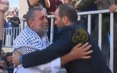 The father of Raed Jaradat and the father of Daania Arshid embrace after 'betrothing' their dead children to each other to be married as 'martyrs' in heaven, October 31, 2015. (screenshot: YouTube)