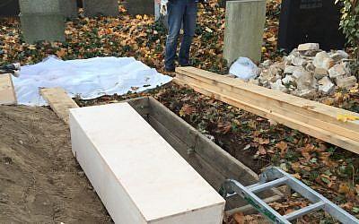 A coffin at a Berlin Jewish cemetery being prepared for shipment to Chicago, November 4, 2015. (Chevra Kadisha/JTA)