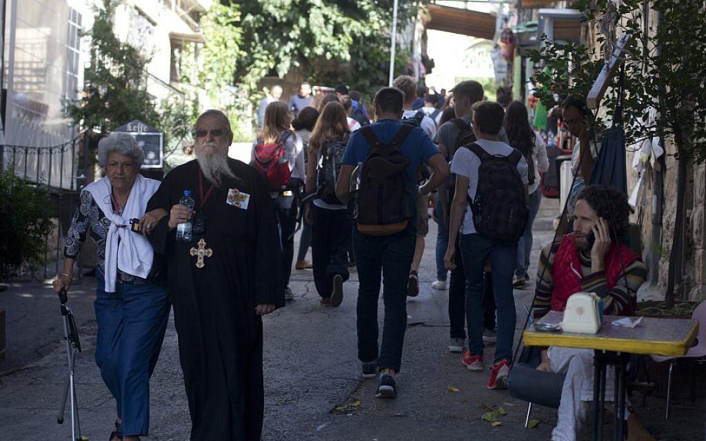 Tourists walk next to the Church of St. John the Baptist in Jerusalem's Ein Karem neighborhood on November 03, 2015 (Lior Mizrahi/Flash90)