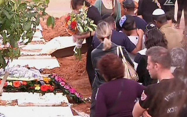 Mourners at a funeral for a 13-year-old girl who committed suicide in Kfar Saba on November 25, 2015. (screen capture: Channel 2)