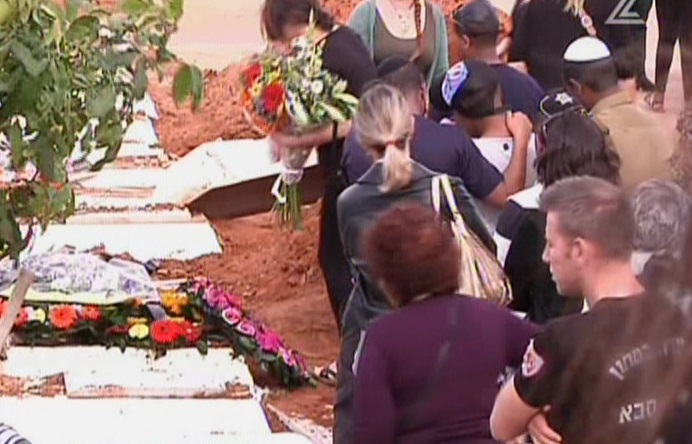 Mourners at a funeral for a 13-year-old girl who committed suicide in