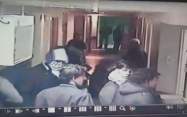 Security camera footage purporting to show undercover Israeli troops entering a Hebron hospital on November 12, 2015. (screen capture: YouTube)