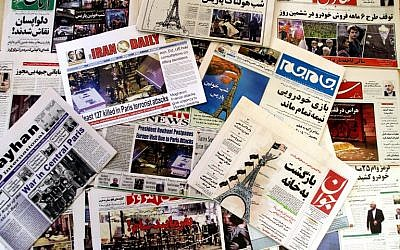 A photo taken on November 15, 2015. in the Iranian capital of Tehran shows newspapers bearing the headlines of the deadly Paris attack that killed at least 129, as conservative papers said France was paying for its policies in Syria. (AFP/Atta Kenare)