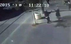 In a still image from security camera of the scene, a young Palestinian girl lashes out with a pair of scissors in an attack in Jerusalem on November 23, 2015 (screen capture: Channel 2)