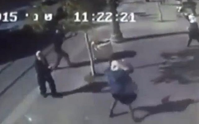 In a still image from security-camera footage of the scene, a young Palestinian girl (center) lashes out with a pair of scissors in an attack in Jerusalem on November 23, 2015. (screen capture: Channel 2)