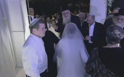 Sarah Litman and Ariel Biegel under huppah at their wedding on November 26, 2015 (screen capture: YouTube)
