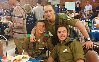IDF lone soldiers from the US enjoy a Thanksgiving dinner on November 26, 2015. (Simona Weinglass/Times of Israel)