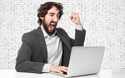 (Angry man with laptop image via Shutterstock)