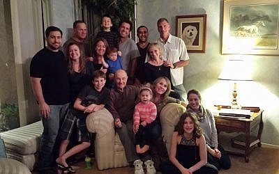 Norm Sherry, seated, surrounded by his children, grandchildren and great-grandchildren, January 2014. (Courtesy of Cyndi Sherry Fedele/via JTA)