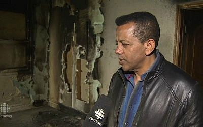 Kawartha Muslim Religious Association president Kenzu Abdella surveys the fire damage to his Peterborough, Ontario, mosque after what authorities say was a deliberate arson attack that may have targeted the Muslim community in revenge for the Paris terror attacks, November 15, 2015. (screenshot: CBC News)