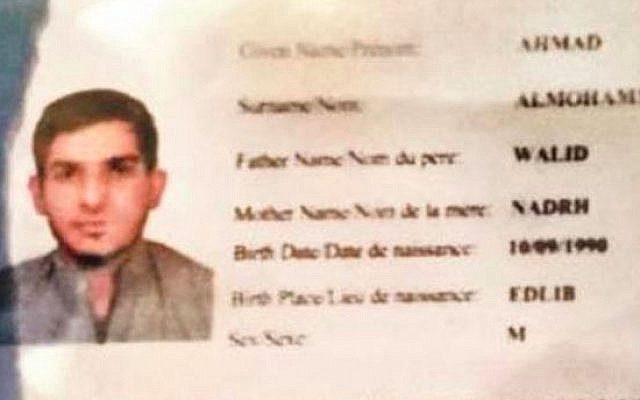 An image of the Syrian passport found at the Stade de France after the bombings there on November 13, 2015