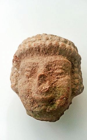 The head of an Iron Age statuette found by an 8-year-old while walking near Tel Beit Shemesh. (Alexander Glick, courtesy of Israel Antiquities Authority)