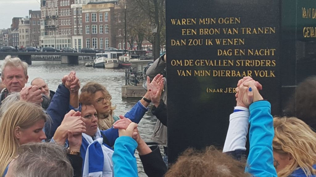 Pro-Israel demonstrators outside of a speech by United (Arab) List MK Hanin Zoabi at a Kristallnacht commemoration event in Amsterdam, Netherlands on November 8, 2015. (Photo credit: Matt Lebovic)