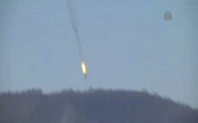A Russian jet plunges to the ground after being shot down by Turkey near the border with Syria on November 24, 2015. (screen capture: Anadolu Agency)