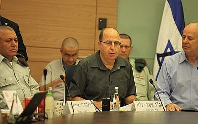 Defense Minister Moshe Ya'alon (C), Chairman of the Foreign Affairs and Defense Committee Tzachi Hanegbi (R) and IDF Chief of Staff Gadi Eisenkot attend a Foreign Affairs and Defense Committee meeting at the Knesset in Jerusalem on November 3, 2015. (Issac Harari/Flash90)