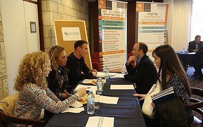 Israeli academics teaching abroad discuss job prospects in Israel at an event sponsored by the Israel Academy of Sciences and Humanities (Courtesy)