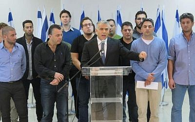 Yesh Atid party leader MK Yair Lapid (center) together with  Amit Deri (2nd right) IDF reserve officers and soldiers at a press conference against the Breaking the Silence group, December 20, 2015. (Yesh Atid spokesperson)