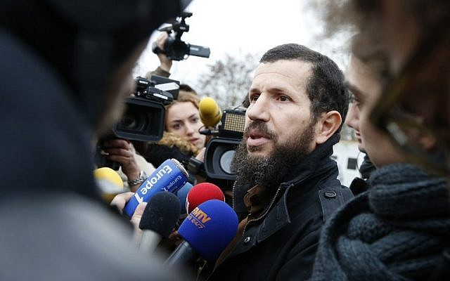 Mohammed Ramdane, the president of the Lagny-sur-Marne Mosque association, speaks to the press on December 2, 2015 outside the recently closed mosque. (AFP/THOMAS SAMSON)