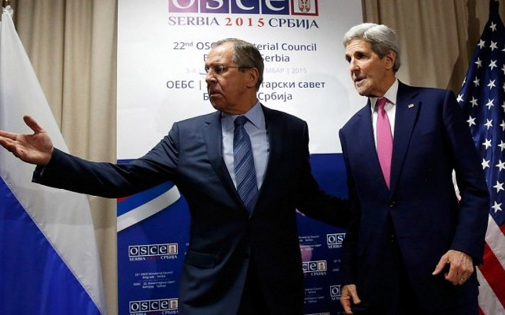 Russian Foreign Minister Sergei Lavrov (L) invites US Secretary of State John Kerry to a sitting area as he arrives for their bilateral meeting alongside the annual Organization for Security and Cooperation in Europe (OSCE) Ministerial Council meeting in Belgrade on December 3, 2015. (AFP/POOL/JONATHAN ERNST)