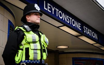 A police officer stands guard outside Leytonstone station in north London on December 6, 2015, a day after three people were stabbed by Zakaria Bulhan,  a 19-year-old Somali-Norwegian man (AFP/LEON NEAL)