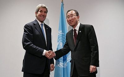 US Secretary of State John Kerry  shakes hands with United Nations Secretary General Ban Ki-moon as they pose after a meeting on the sidelines of the COP 21 United Nations conference on climate change on December 8, 2015 in Le Bourget, on the outskirts of Paris. (AFP / POOL / MANDEL NGAN)