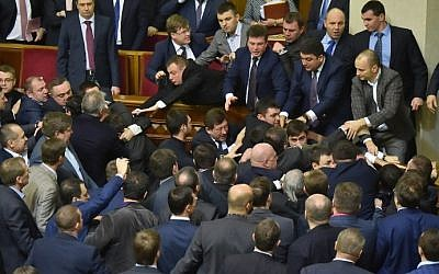 Deputies of Ukrainian Parliament fight after the attack of the Ukrainian Prime Minister during the annual report of the government in Ukrainian Parliament in Kiev on December 11, 2015. (AFP / Sergei SUPINSKY)