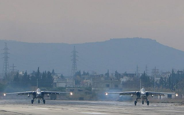 File: Two Russian Sukhoi Su-24 bombers at the Russian Hmeimim military base in Latakia province, in the northwest of Syria, on December 16, 2015. (Paul Gypteau/AFP)