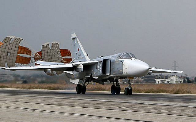 File: A Russian Sukhoi Su-24 bomber lands at the Russian Hmeimin military base in Latakia province, in the northwest of Syria, on December 16, 2015. (Paul Gypteau/AFP)