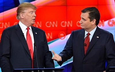 Republican presidential candidate businessman Donald Trump (L) speaks with Texas Sen. Ted Cruz during a break in the Republican Presidential Debate, hosted by CNN, at The Venetian Las Vegas on December 15, 2015 in Las Vegas, Nevada (AFP PHOTO/Robyn Beck)