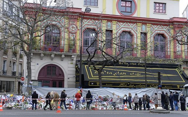 People gather to lay flowers at a makeshift memorial in front of the Bataclan concert hall on November 29, 2015, Paris. (AFP/MIGUEL MEDINA)
