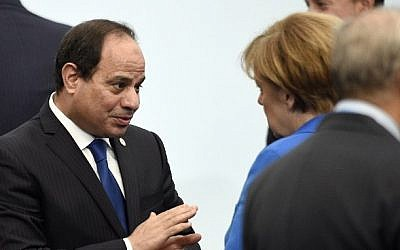 Egyptian President Abdel Fattah el-Sissi (left) talks with German Chancellor Angela Merkel at COP21, the UN Climate Change Conference, in Le Bourget, outside Paris, France, on November 30, 2015. (AFP/Martin Bureau/Pool)