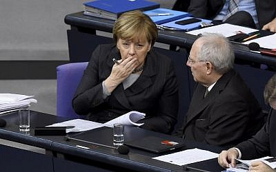 German Chancellor Angela Merkel (left) talking to German Finance Minister Wolfgang Schaeuble during a plenary session of the Bundestag in Berlin before deputies vote on a stepped-up German role in the fight against the Islamic State, December 4, 2015. (AFP/Tobias Schwarz)