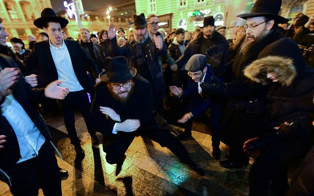 Hanukkah celebrants dance and sing at Nyugati Square in Budapest, December 6, 2015, the first day of the eight-day festival. (AFP Photo/Attila Kisbenedek)