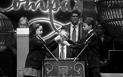 "Pupils from San Ildefonso school sing out numbers during the draw of Spain's Christmas lottery named ""El Gordo"" (The Fat One) at the Teatro Real in Madrid, on December 22, 2015. (AFP Photo/Pierre-Philippe Marcou)"