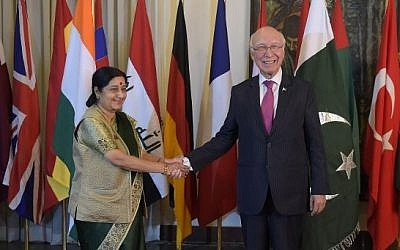Pakistan's National Security Adviser Sartaj Aziz (right)  shakes hands with Indian Foreign Minister Sushma Swaraj at Pakistan's foreign ministry in Islamabad on December 9, 2015, ahead of talks. (AFPAamir Qureshi)