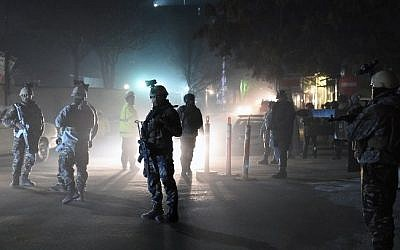 Afghan Crisis Response Unit personnel stand guard at the site of bomb attack on the Spanish embassy compound in Kabul on December 11, 2015 (AFP/Wakil Kohsar)