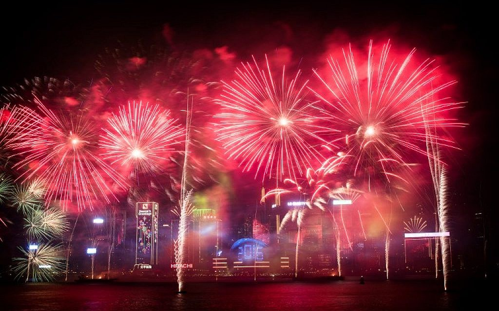 Fireworks are seen over the city's skyline in Hong Kong on January 1, 2016 as part of the 2016 new year celebrations. (AFP PHOTO / Philippe Lopez)