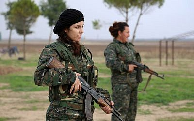 "Syriac Christian women, members of the battalion called the ""Female Protection Forces of the Land Between the Two Rivers"" fighting the Islamic State group, take part in a training on December 1, 2015 at their camp in the town of al-Qahtaniyah, near the Syrian-Turkish border (aka Kabre Hyore in Syriac, and Tirbespi in Kurdish).(AFP PHOTO / DELIL SOULEIMAN / AFP / DELIL SOULEIMAN)"