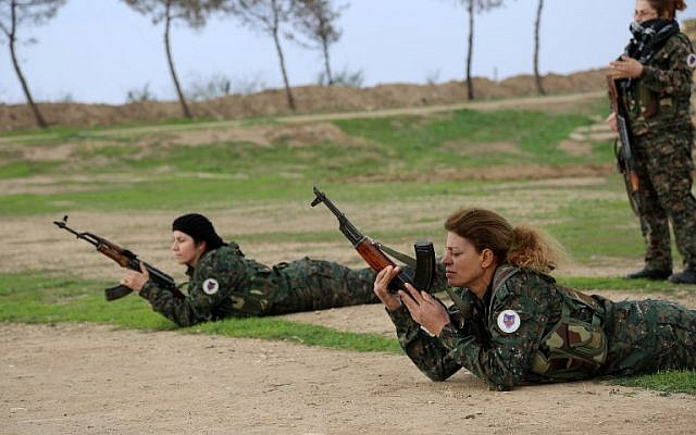 "Syriac Christian women, members of the battalion called the ""Female Protection Forces of the Land Between the Two Rivers"" fighting the Islamic State group, take part in a training on December 1, 2015 at their camp in the town of al-Qahtaniyah, near the Syrian-Turkish border (aka Kabre Hyore in Syriac, and Tirbespi in Kurdish). (AFP PHOTO / DELIL SOULEIMAN / AFP / DELIL SOULEIMAN)"