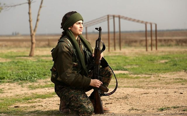 "Syriac Christian Lucia, member of the battalion called the ""Female Protection Forces of the Land Between the Two Rivers"" fighting the Islamic State group, poses during a training on December 1, 2015 at their camp in the town of al-Qahtaniyah, near the Syrian-Turkish border (aka Kabre Hyore in Syriac, and Tirbespi in Kurdish). (AFP PHOTO / DELIL SOULEIMAN / AFP / DELIL SOULEIMAN)"