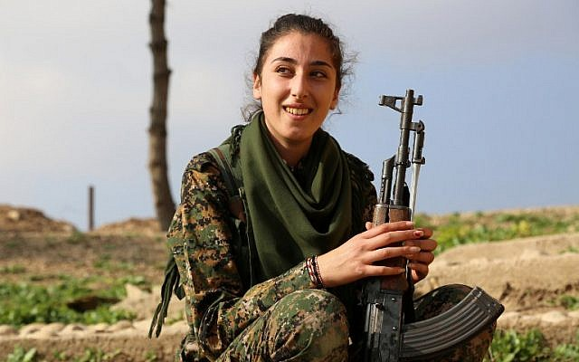 "A Syriac Christian fighter, member of the battalion called the ""Female Protection Forces of the Land Between the Two Rivers"" fighting the Islamic State group, poses during a training on December 1, 2015 at their camp in the town of al-Qahtaniyah, near the Syrian-Turkish border (aka Kabre Hyore in Syriac, and Tirbespi in Kurdish).(AFP PHOTO / DELIL SOULEIMAN / AFP / DELIL SOULEIMAN)"