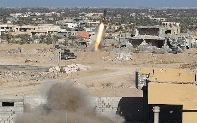 Iraqi security forces fire a rocket propelled grenade in the rural town of Husayba, east of Ramadi, where government forces have been closing on Islamic State who seized the Anbar province's capital in May after a three-day blitz involving dozens of huge truck bombs. (Ahmad al-Rubaye/AFP)